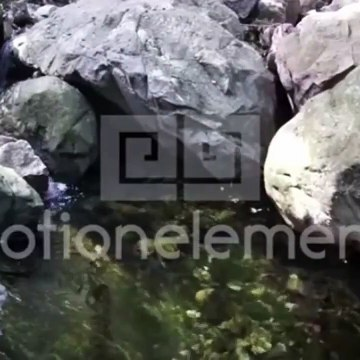 Relaxing Water through the rocks with sound