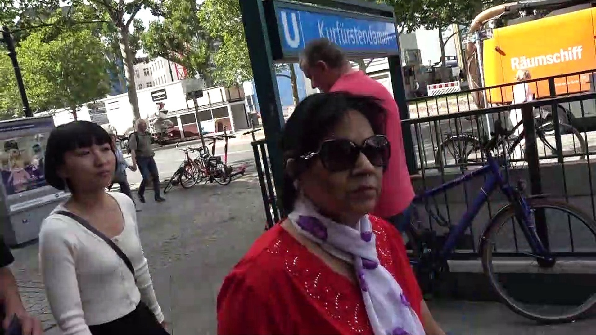 BDMV-211 Aruna & Hari Sharma walking at Kurfürstendamm 227-229, 10719 Berlin Aug 13, 2019