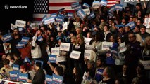 Crowd chants 'Not Me. Us' as Bernie Sanders takes the stage in Iowa despite delay in results