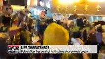 Hong Kong police fire warning shot and use water cannon on protesters