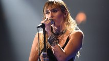 Miley Cyrus debuts new break-up tattoo in first performance since marriage split