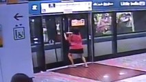 Women opens subway station platform doors with bare hands to board train in