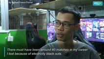 Armed with smartphones, Myanmar e-sports players battle power outages