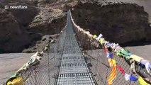 Nerve-wracking moment UK couple cross windy bridge in Nepal