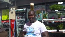 Refugee and Schalke fan fights racism by cycling with beer on his head