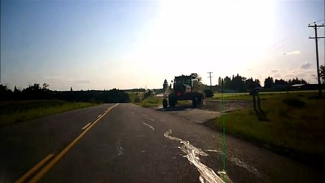 MCH 176 FARMERS DRIVING TRACTOR ON THE BACK ROADS, OF ALBERTA CANADA.