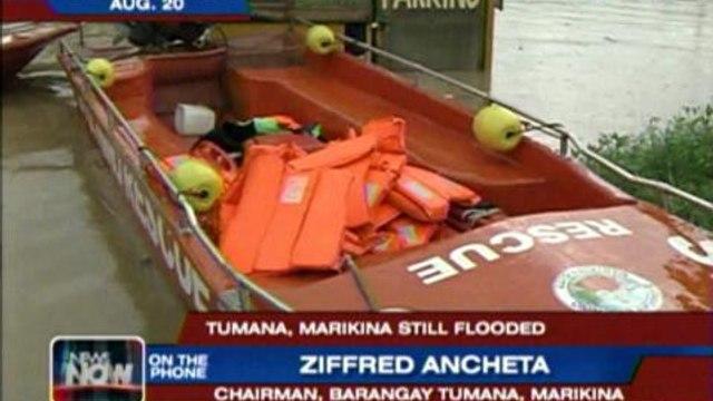 Flood victims crowd evacuation centers in Tumana