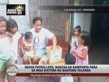 Bayan Patrollers help through 'Tulong Na' shirts