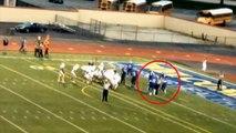 Un joueur de football américain donne un coup de tête à un arbitre