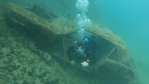 Scuba Divers Find Abandoned Cars While Exploring