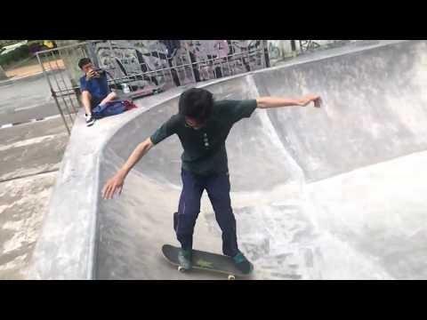 Skateboarder Slips and Falls on Concrete Ramp