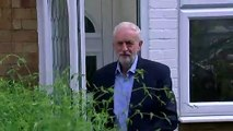 Reporter attempts to present Corbyn with pink blouse