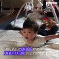 Un bébé qui vole avec un ventilateur