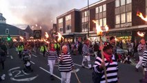 Scores march through English town with torches for bonfire season