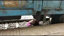 Elderly woman miraculously escapes after falling under train in south India