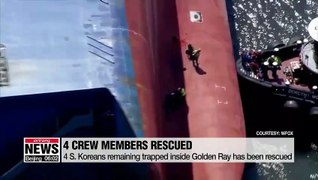 Rescuers pull out men trapped inside capsized cargo ship