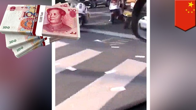 Thousands in Chinese moneyfound scattered all over the road
