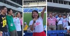 Des supporters japonais chantent l'hymne sud-africain