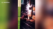 Faulty voltage transformer explodes sending sparks onto Chinese street