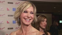 Olivia Newton-John to auction off Grease jacket in 'grand scale garage sale'
