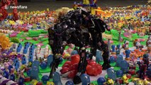 Artist makes dinosaur exhibition out of thousands of discarded plastic toys in Thailand