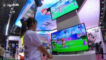 Visitors test official video game of Tokyo 2020 Olympics at Japanese gaming event