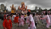 Devotees bid farewell to Ganesh at festival climax