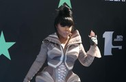 Lil' Kim 'unapologetic' with her outfits