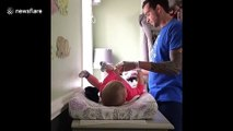 Hilarious moment Michigan dad struggles changing newborn daughter for the first time