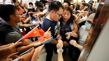 Pro and anti-Beijing groups scuffle in Hong Kong mall