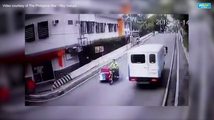 CCTV footage of an unidentified man throwing a grenade in front of Manila restaurant