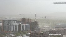 Construction cranes sway as gusty Arizona dust storm whips through town
