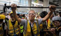 Uncle Wong, 82: protecting Hong Kong protesters with his walking stick – video