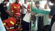 Chinese firemen free six-year-old boy's head from glass doors