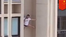 Man spideys high-rise while talking on his phone