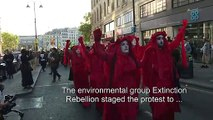 """Environmental group Extinction Rebellion mark end of London fashion week with """"funeral procession"""""""