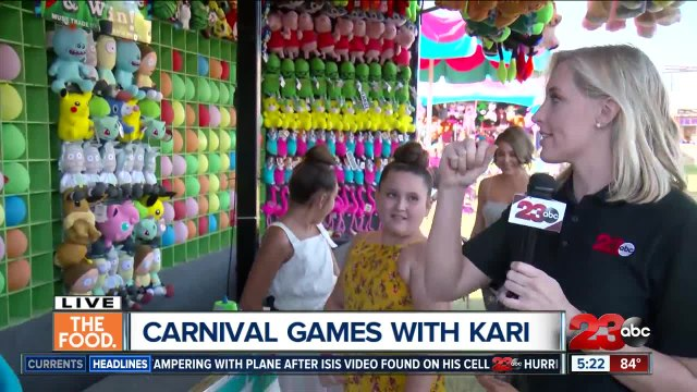 Kari tests out the 'Balloon Bust' at the Kern County Fair