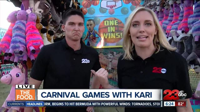 Kari and Matt take on the Kern County Fair games