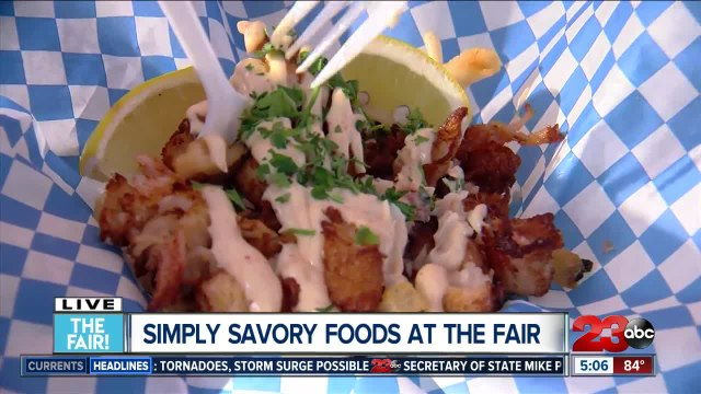 Allison Gargaro tries lobster fries at the fair