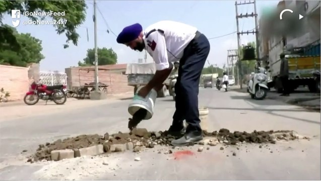 Punjab Traffic Policeman Earns Praise For Filling Potholes