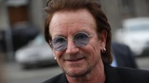 Bono teams up with street artists to fight AIDS