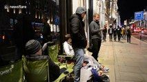 iPhone enthusiasts queue all night at London's flagship Apple store for new release