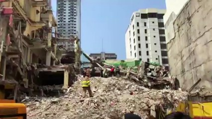 Footage of rescue operation at collapsed hotel building in Manila