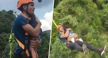 Ce papa saute à l'élastique avec sa fille dans les bras alors qu'elle n'est pas attachée