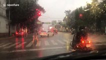 Strong storm causes heavy traffic in busy streets