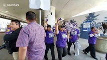 Rideshare drivers and union workers march at Los Angeles airport block traffic to demand better rights