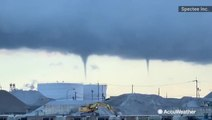 Multiple waterspouts start to spiral down