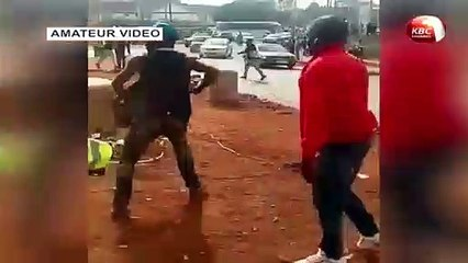 Nairobi residents scramble for free beer after a truck ferrying them overturned