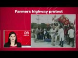 Farmers Spill Onto Highway