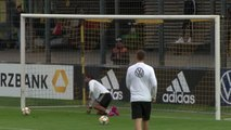 Gnabry has a go in goal during Germany training